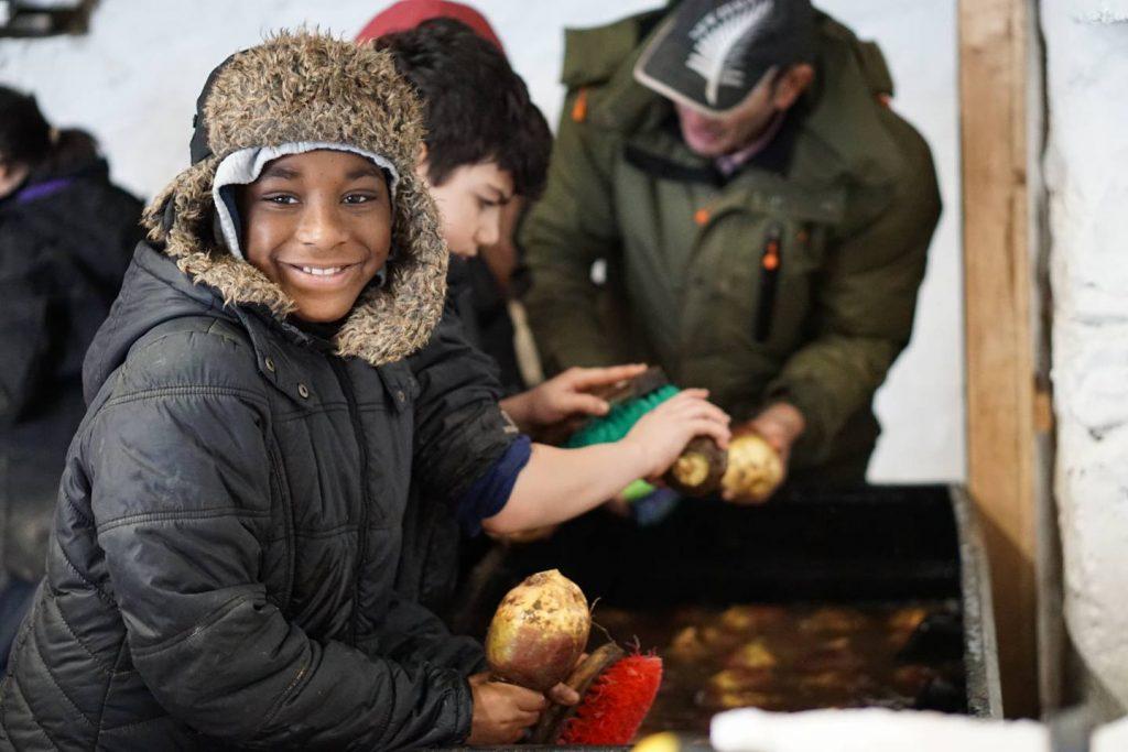 Charitably Joules - boy farming potatoes