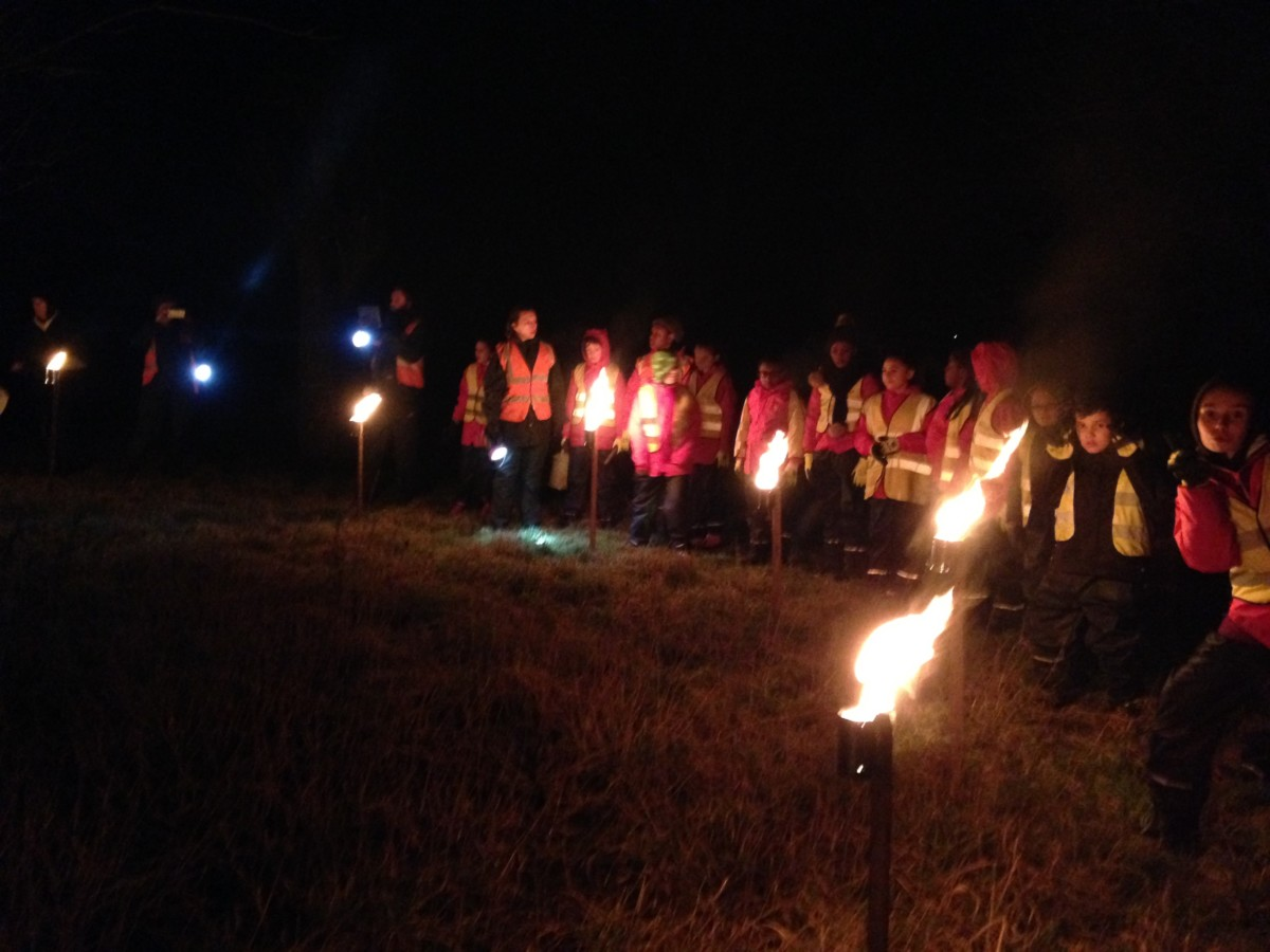 Wassail - people standing by burning torches